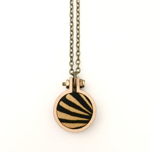 recycled fabric pendant . black and yellow stripes .