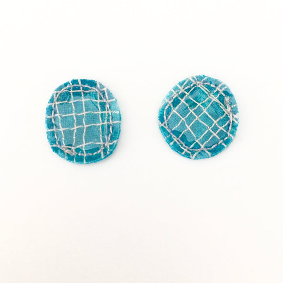 stitched statements . studs . blue pool .