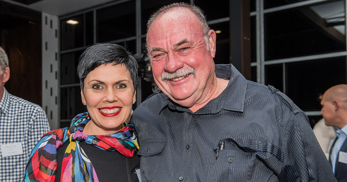 Hon Warren Entsch and his wife, Yolonde wearing a Sacred Vine silk scarf