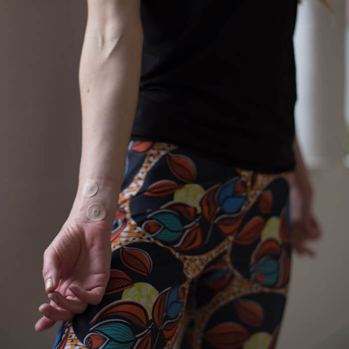 Yoga Teacher wearing the Acupressure Freckles during an AcuYin class