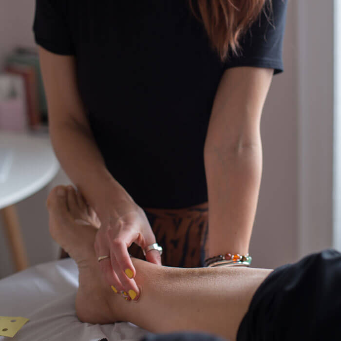 Acupuncturist using Acupressure Freckles during acupuncture treatment