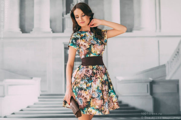DM00248BR chocolate dress with a full skirt and pockets at the shoulder with large flower print