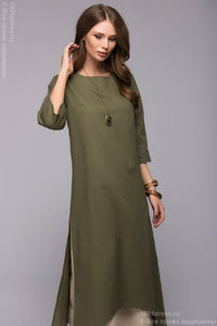 DM00651GR green dress with a boxy fit and a double skirt