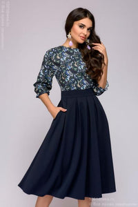 DM00234BL blue dress MIDI length with a printed top and a batwing sleeve