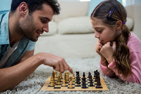 Family chess father teaching daughter