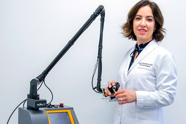 An image of Dr. Heidi with a CO2 Laser Resurfacing machine.