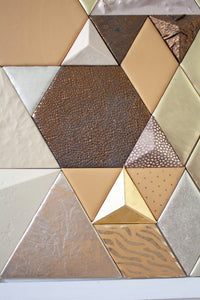 Triangle Bronze and white Leather Tiles on a panel