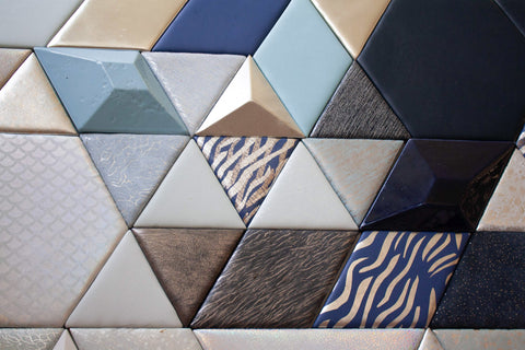 Blue and white leather tiles on a panel