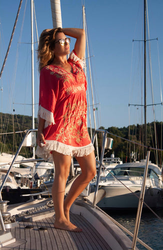 Girl with Coral afterbeach dress on boat
