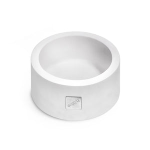 Round white dog bowl in Corian material