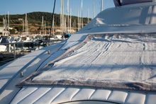 Load image into Gallery viewer, Grey Cotton Beach Towel on a yacht