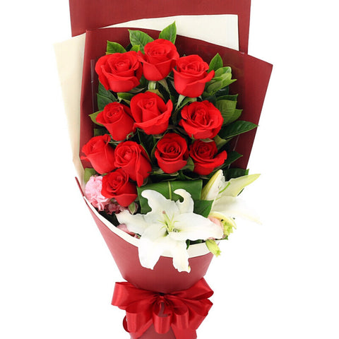 Romantic flowers( 11 red roses + 1 long lily)