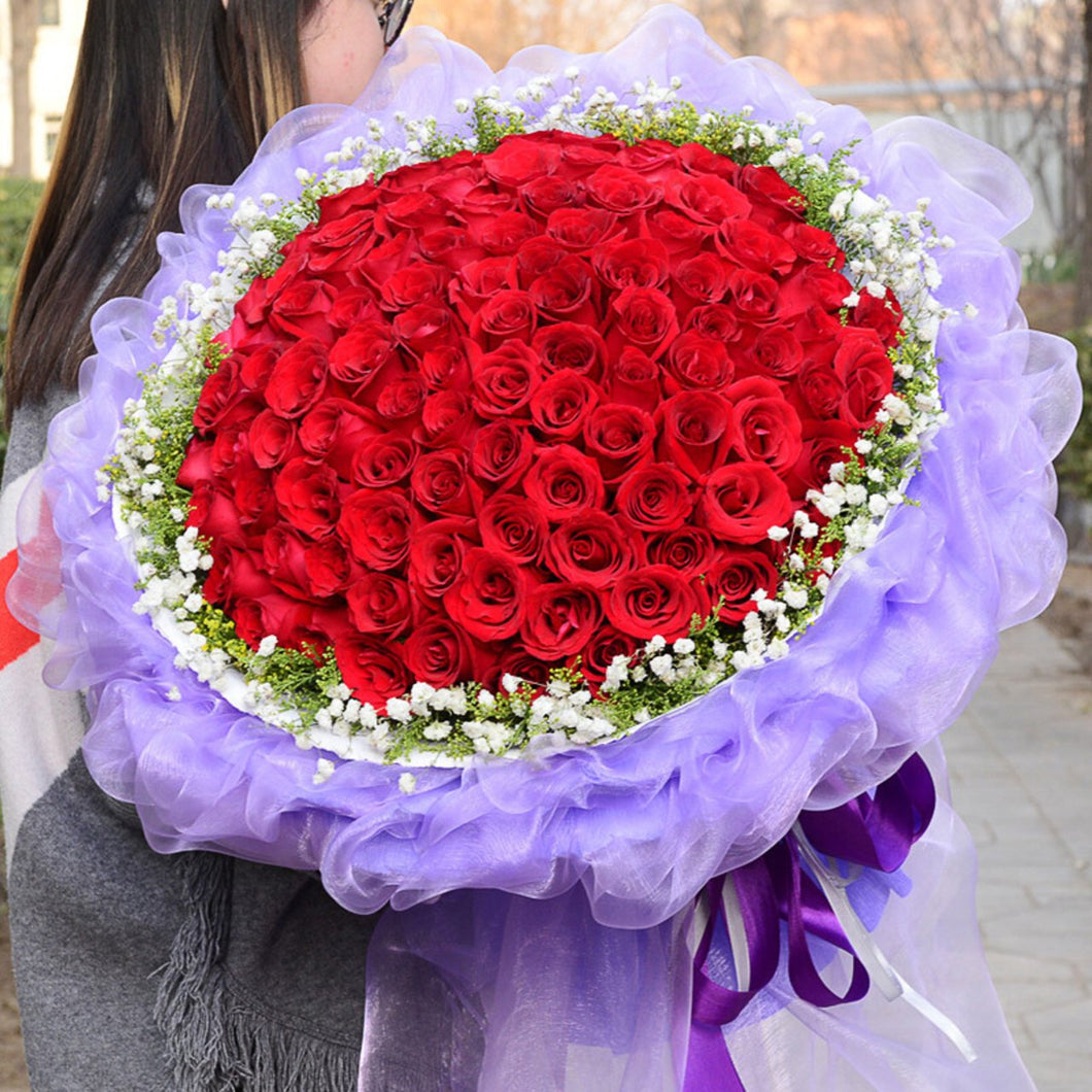 Flying love(99 premium red roses with white sur)