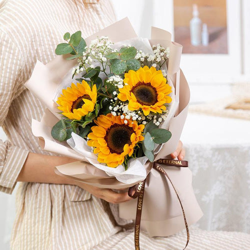 Positive belief(3 sunflowers with white gypsophila )