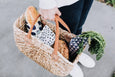 Basket filled with fresh produce wrapped in wintering beeswax wraps