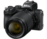 Nikon Z 50 Mirrorless Camera with 16-50mm VR and  50-250 VR Lens options.