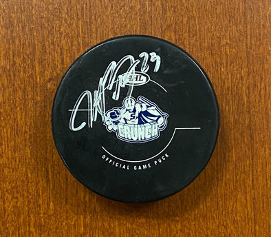 #23 J.T. Brown Autographed Game Puck - 2012-13