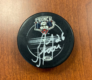 #26 Greg Moore Autographed Game Puck - 2009-10