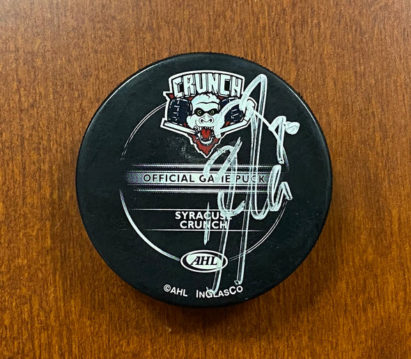 #70 Kris Russell Autographed Game Puck - 2008-09