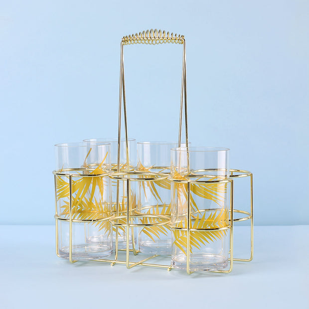 Gold metal bottle caddy with six slots.