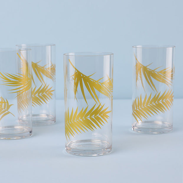 Set of four highball glasses with gold palm trees.