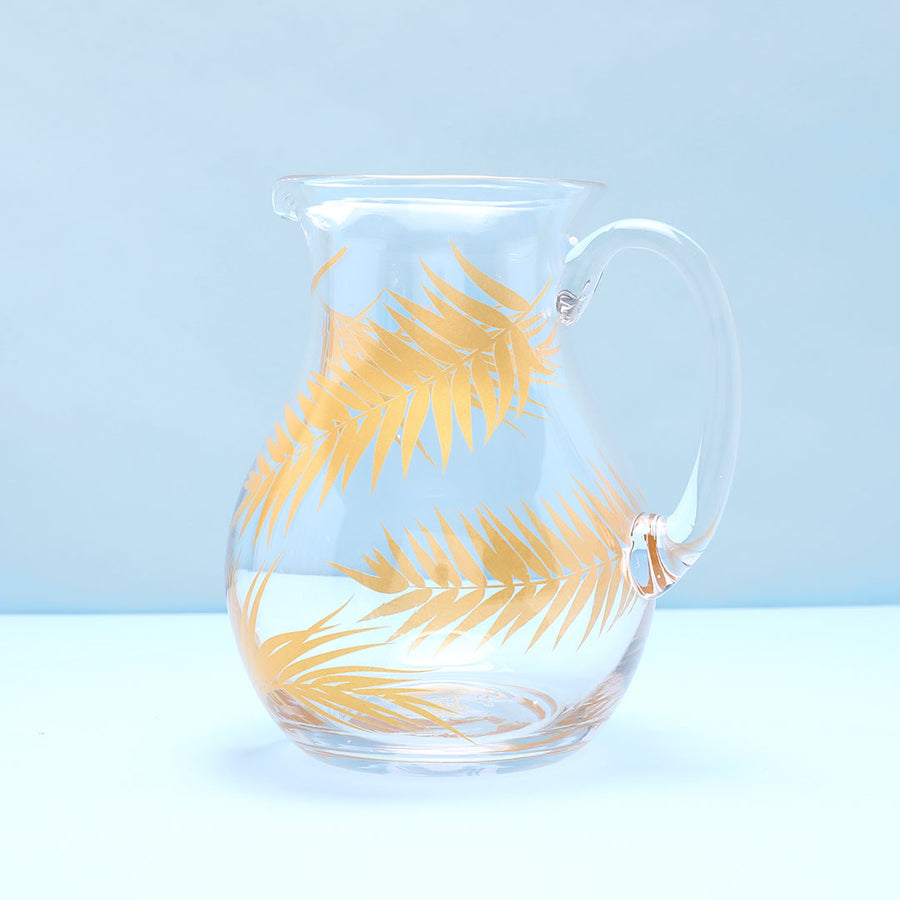 Glass pitcher with gold palms.