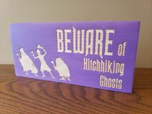 Beware of Hitchhiking Ghosts wood door sign