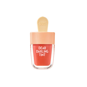 Dear Darling Lip tint, packaging in the form of an ice lolly with a stick. Peach colour glass container with beige straw like shaped handle