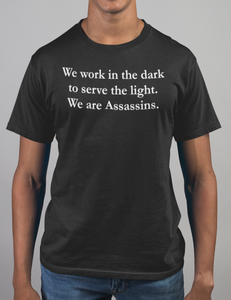 We Work In The Dark To Serve The Light | T-Shirt