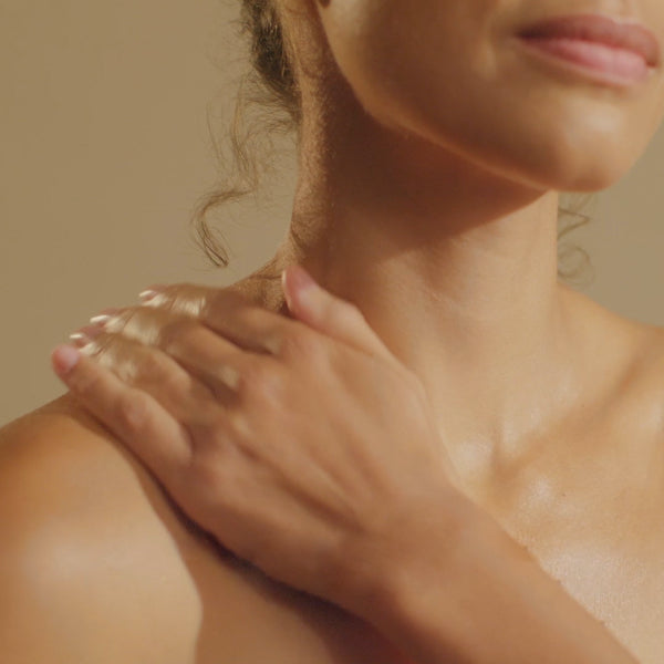 Woman massaging Hydro Serum into neck