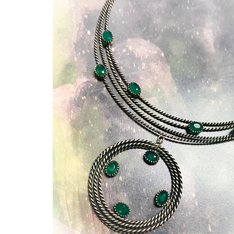 Sterling Silver Twisted Lines Necklace with Green Crystals