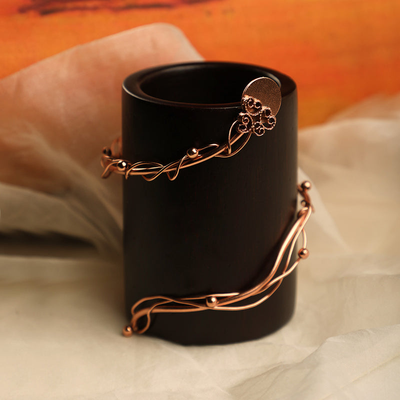 Wooden tea light holder with rose gold wire and filigree detailing