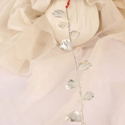 Silver plated metal toran embellished with entwined wire petals detailing