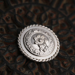 92.5 Sterling Silver Coin with entwined border and bold floral emblem detailing