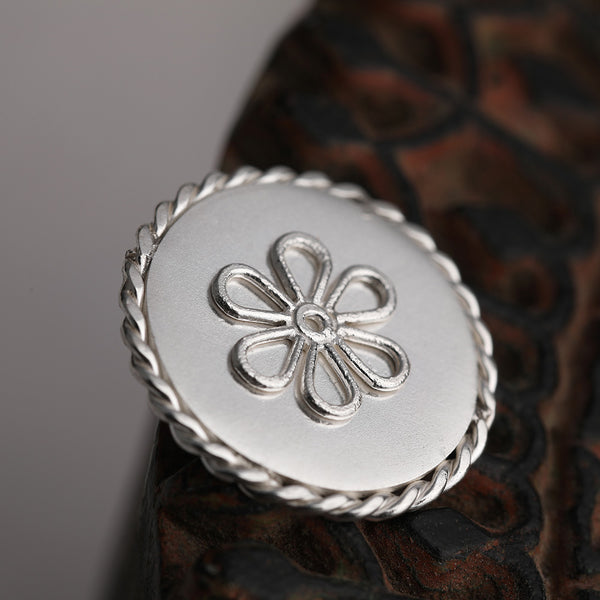 92.5 Sterling Silver Coin with entwined border and delicate flower outline detailing