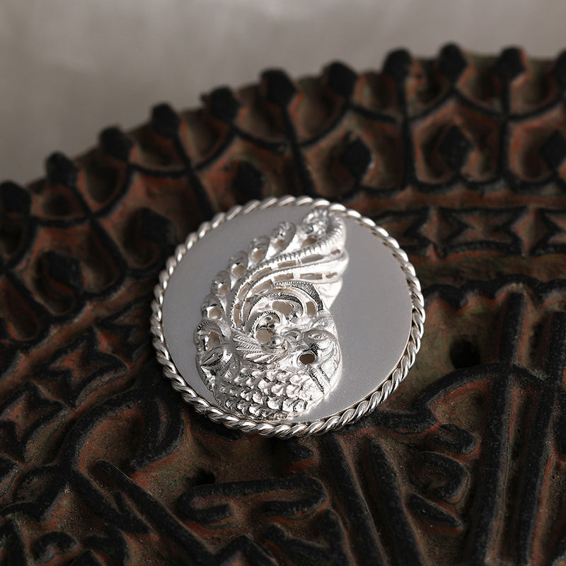 92.5 Sterling Silver Coin with entwined border and decorative peacock detailing
