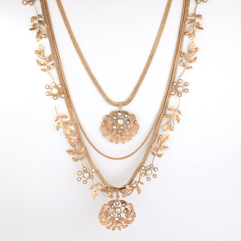 Gold toned layered necklace with serrate and pearl embellishment