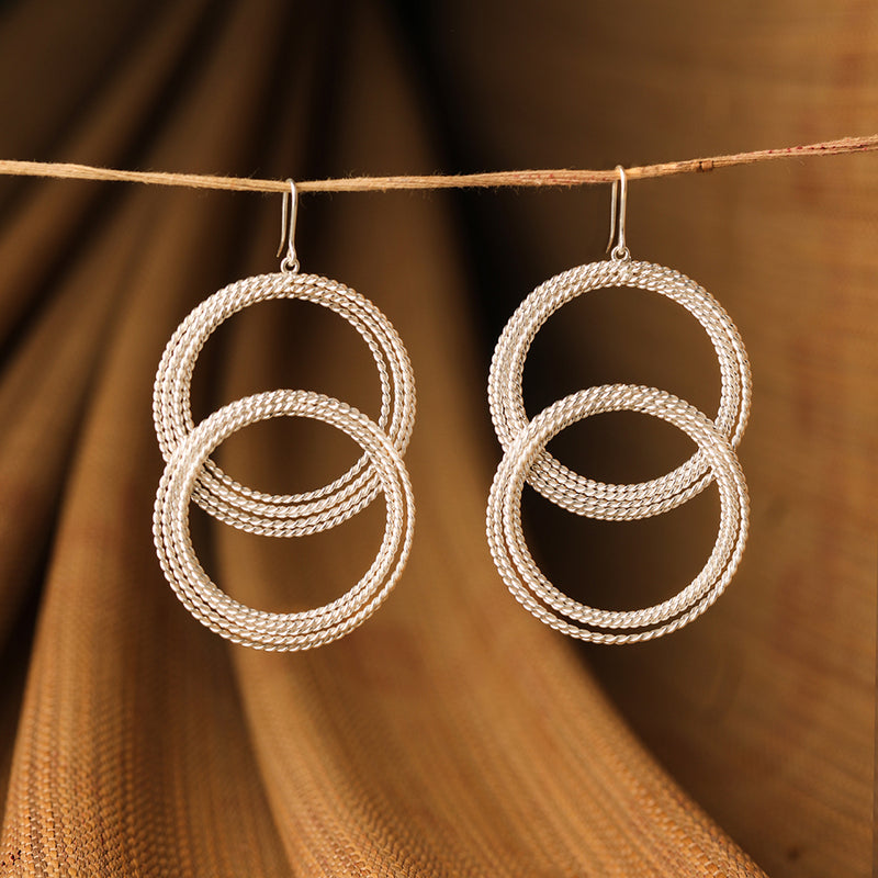 Twisted loop hoops