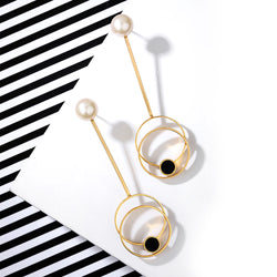 Gold Toned Circle On Circle Pendulum Earrings With Black Perspex & Pearl Detail