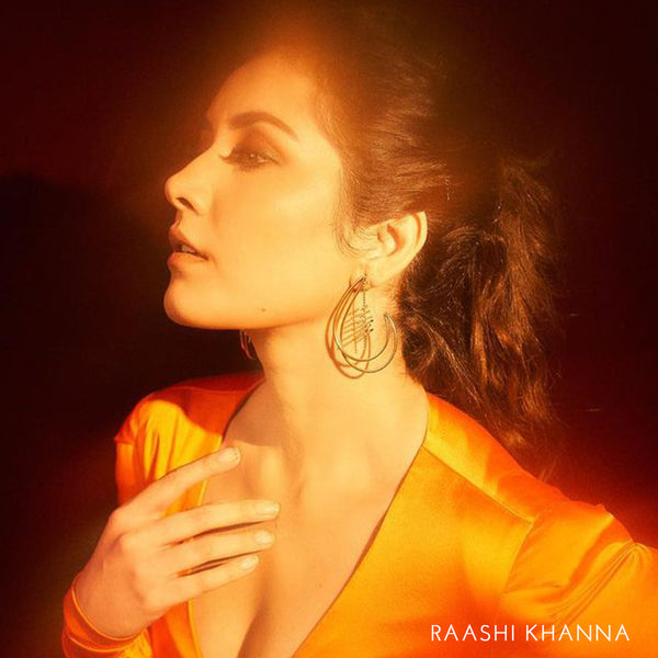 Decorative mismatched earring - worn by raashi khanna