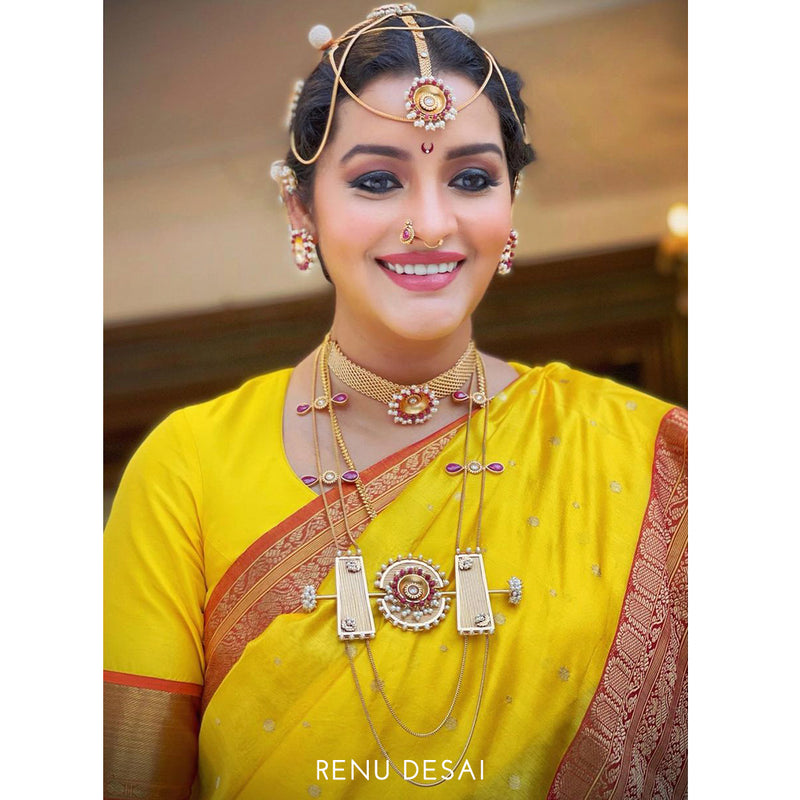 Gold toned flat chain mangtika with ruby and pearls - Worn by Renu Desai