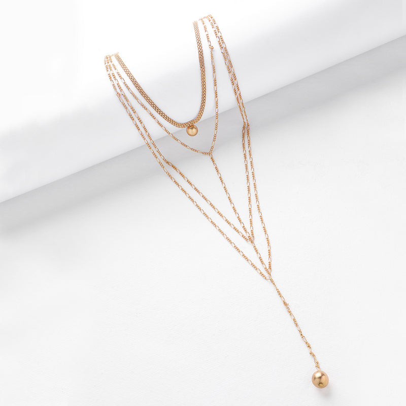 Gold Toned Multi-Chain Lariat Necklace with Ball Details