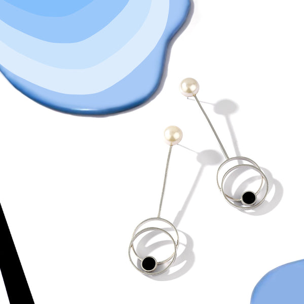 Silver Toned Circle On Circle Pendulum Earrings With Black Perspex & Pearl Detail