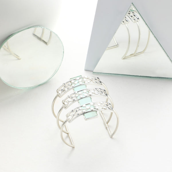 SILVER TONED TRIPLE LINED DOTTED CUFF OVERLAID ON CYAN ACRYLIC BLOCK