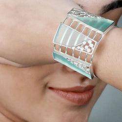 SILVER TONED LINED CUFF WITH SPLIT DOTTED & CYAN ACRYLIC BLOCKS