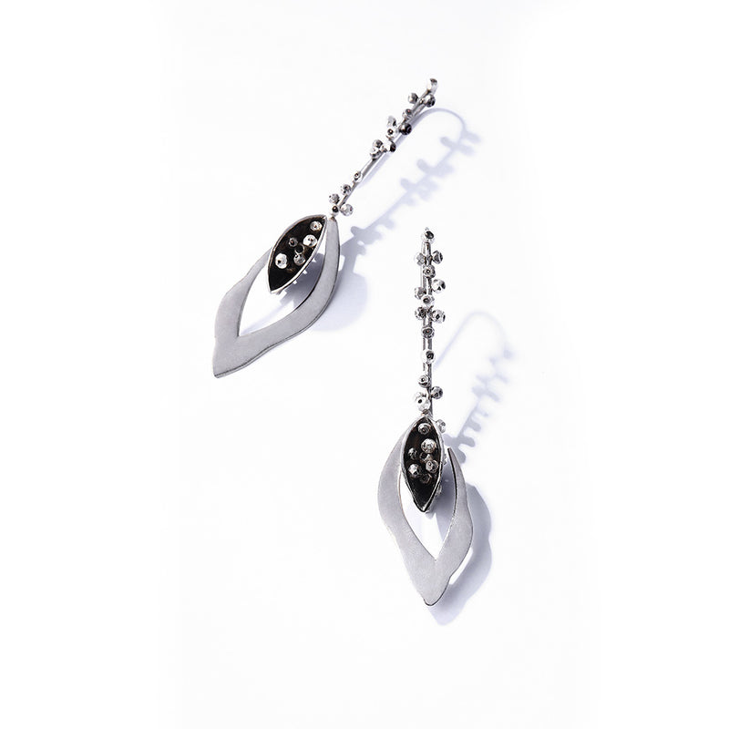 Silver Toned Pod Earrings With Pyrite Bead Details