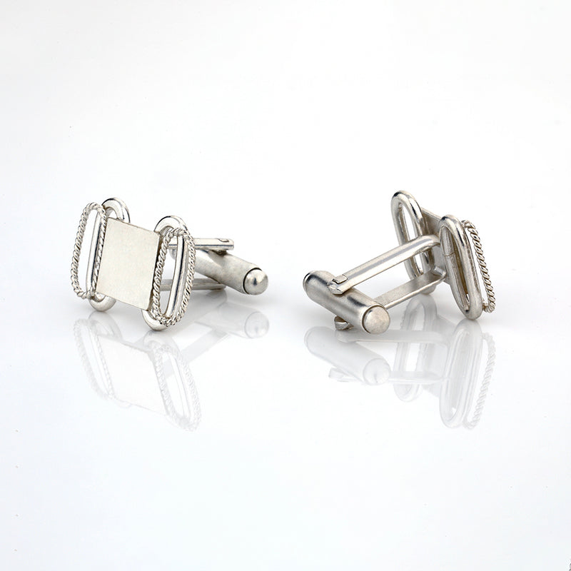 Silver toned cufflinks with oval twisted wire detail