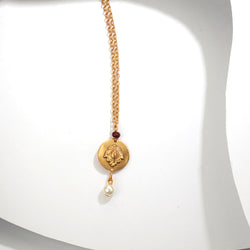 GOLD TONED LUMBA RAKHI WITH FLORAL MOTIF , SANDALWOOD BEAD & PEARL TIP