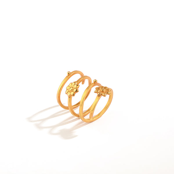 GOLD PLATED SPIRAL RING WITH ENGRAVING 2 ROUNDED FLOWER AND 2 DOTS ON IT