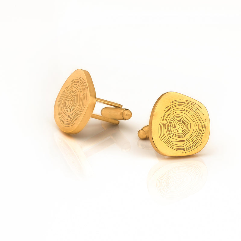 BOLD ASYMMETRICAL CUFFLINK WITH ORGANIC IMPRINT